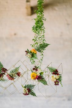 I like to think we've seen all the best moments in wedding design, but once this shoot from Sebesta Design hit our desks all bets were off. From the industrial setting to the mixed textures, geometric accents...and that vine-covered wire installation? Pure