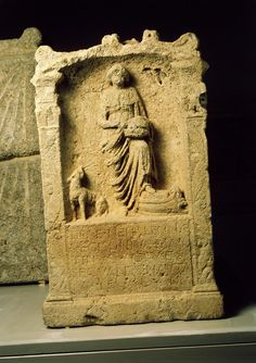 Nehalennia Circa 200 AD, limestone, height 76 cm, Colijnsplaat (Oosterschelde, province of Zeeland)  Votive altar for the local Roman goddess Nehalennia. Likely there was a temple that was swallowed by the sea.  Nehalennia is a fertility goddess, the patroness of hearth,home and seafarers.  Inscription: 'To the goddess Nehalennia Vegisonius Martinus, citizen from the land of the Sequani and seaman, has redeemed his vow, willingly and with reason.'