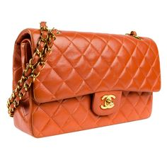 Chanel Orange Flap Bag | From a collection of rare vintage handbags and purses at http://www.1stdibs.com/fashion/accessories/handbags-purses/