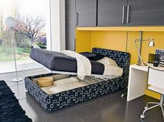Inspirational Ideas For Unique Bedroom Furniture Design Featuring Black Pattern Upholstery Fabric Bed Frame With Under Storage Flip Top Mattress And Stunning Black Yellow Color Paint Wooden Wall Unit Cupboard To Space Saving Inspiration, Trendy Bedrooms Ideas With Unique Bedroom Furniture Design: Bedroom, Furniture, Interior