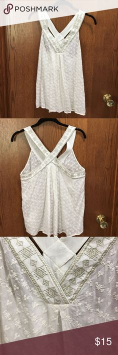 Lucky Brand Ivory racer back tank top Lucky Brand Ivory racer back tank top with gold stitching detail on straps. Loose fitting. 55% rayon 45% cotton. Machine wash. Lucky Brand Tops Tank Tops