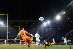Cristiano Ronaldo Photos - Cristiano Ronaldo of Real Madrid scores his sides second goal past Roman Buerki of Borussia Dortmund during the UEFA Champions League group H match between Borussia Dortmund and Real Madrid at Signal Iduna Park on September 26, 2017 in Dortmund, Germany. - Borussia Dortmund v Real Madrid - UEFA Champions League