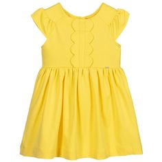 Perfect for summer days, a soft cotton jersey dress for girls by Mayoral. It has sweet capped sleeves and scalloped edged ruffles on the bodice, with a small branded silver charm and back zip fastening. Designer Dresses For Kids, Designer Kids Clothes, Teddy Bear Clothes, Short Sleeve Dresses, Dresses With Sleeves, Girls Dresses, Summer Dresses, Yellow Dress, Clothes For Sale