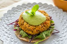 25 Delicious Vegan Sources of Protein (The Ultimate Guide!). Vegan recipes included. Pictured: Sweet Potato Burgers With Green Tahini Sauce.