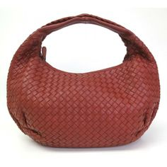 44ae528aff This authentic BOTTEGA VENETA Nappa Belly Veneta is beautifully crafted  from red calfskin. Find this bag on www.swayy.com.au