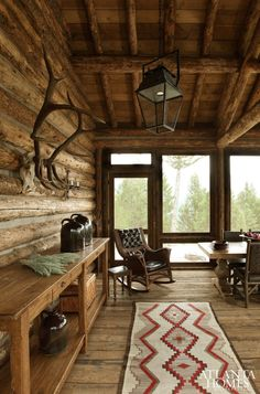 The large, screened-in porch serves as a dining room, living area and sleeping porch for summer guests. // Big Sky, MT