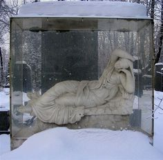 A Soviet funeral monument in the Roman style encased in glass, Novodevichiy Cemetery.