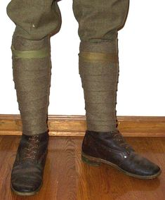 Puttees are strips of cloth wrapped around the leg between the trousers and the boot. They were made to keep the soldiers legs warm, and to prevent anything from catching the trouser leg. During the first world war they were placed quite high up the leg, but they became shorter with time. http://www.aef-doughboys.com/leggings.html
