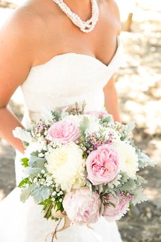 Carly filled her bouquet with two types of large blooms, garden roses and mums, plus tiny wildflowers, baby's breath and lamb's ear for added volume.