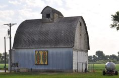 This Barn Quilt is way out west off Route 17 in Kankakee County. Was going to visit a friend in Dwight and made hubby pull over. I love this barn. Shadows and glare make this a hard barn to photograph, but I love the Corn Fed pattern.