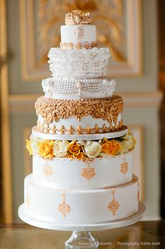 Beautiful Gold and White cake design by Cakes by Krishanthi