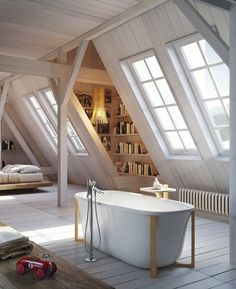 Attic remodel inspiration. Love the slanted windows and airy bath space.