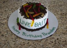 "Live Bait Birthday Cake... Fishing Theme Party... Bake 2 round cakes ( I used 9"" ) Buttercream icing, crushed oreos on top and around the bottom of cake and decorate with gummy worms."