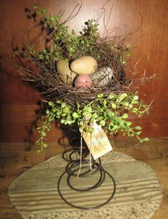 Love this use of an old bed spring for an Easter table accessory