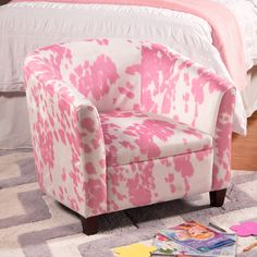 This juvenile accent chair is offered in a fashionable tub shape and chic pink and white faux hide fabric. The bold fabric and pattern will make this chair a conversation piece in any kid's room and also serve as a great spot to relax or read a good book.  Easy assembly.  Spot clean.