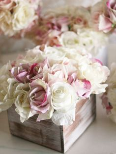 Love the soft colored flowers in a box for a change..instead of glass. lovely.