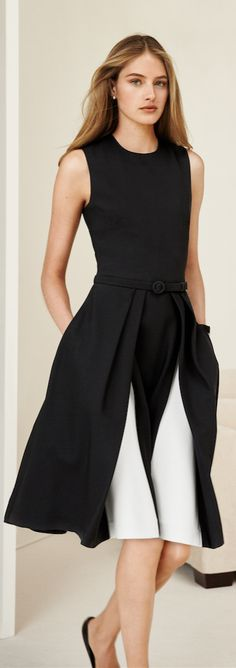 Ralph Lauren Collection Pre-Spring 2015: In Italian silk cady, the Cadence dress' optic black-and-white palette is highlighted with each skirt-swaying step, which reveals its contrasting pleats. The modern fit-and-flare style comes with a removable self-belt that defines the waist.