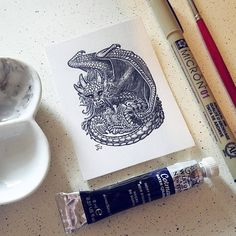 """217 Likes, 14 Comments - Emma Lazauski (@emmalazauski) on Instagram: """"A media experiment with a bristol card. Mother dragon with two cubs, ink and black watercolor."""""""