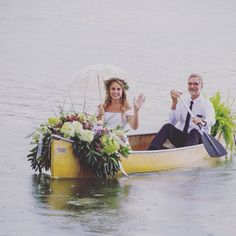 Father paddling bride to ceremony. Amazing canoe arrangement WOW