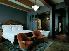 Sliding doors to ensuite: SoHo House is a private members' club and hotel in Manhattan's Meatpacking District with a 700 square foot, King Bed room still available for Valentine's Day http://www.fivestaralliance.com/luxury-hotels/new-york-ny/soho-house-new-york