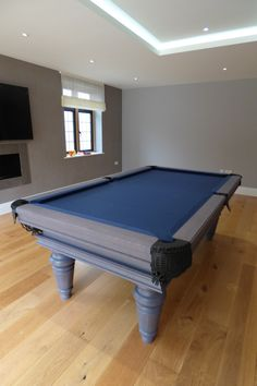 English Traditional Pool Table in our Oak (grey/blue) finish and Hainsworth Smart Navy cloth. Pool Table Sizes, Custom Pool Tables, Pool Table Dining Table, Pool Table Lighting, Blue Pool, Billiard Room, Table Dimensions, Traditional Decor, Cool Pools