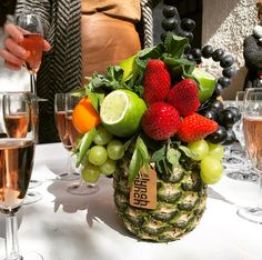 Our #pineapplevase is a great centrepiece for your party decor. See edible arrangements in the link in bio.