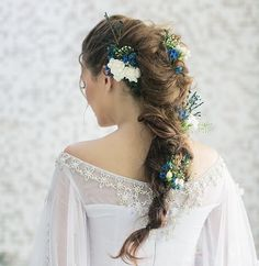 Rapunzel hairstyle with white wedding dress for beach wedding reception. Dreampeeks Photography