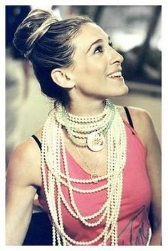 Layers of pearls and the ultimate top knot...Carrie was way before her time.