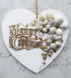 """Made by Sandra Royce - This Christmas decoration features the beautiful """"vintage merry Christmas"""" die which I cut out 3 times and heat embossed twice to make it look like a metal embellishment."""