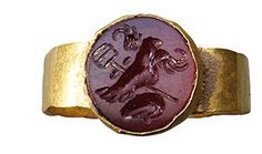Carnelian intaglio ring. Roman, Balkan region, circa 2nd-3rd century AD. The stone depicting the emblems of Mercury.