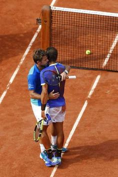 Stan Wawrinka, left, hugs Spain's Rafael Nadal who won his tenth French Open during their men's final match of the French Open tennis tournament at the Roland Garros stadium, in Paris, France, Sunday, June 11, 2017. (AP Photo/Petr David Josek)  The Associated Press