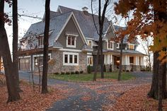 Exterior - Wood shingles, green board and batton, stone, with antique white trim throughout.  Perfect...