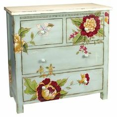 """Four-drawer wood chest in blue with a multicolor floral motif.    Product: ChestConstruction Material: WoodColor: BlueFeatures: Four drawersDimensions: 33.75"""" H x 34"""" W x 16"""" D"""