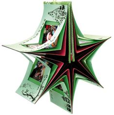 This star carousel book photo shows the layers involved in construction. Book covers are closed back to back at the top. Book Crafts, Crafts To Do, Paper Crafts, Mini Albums, Exploding Box Card, Accordion Book, Star Cards, Album Book, Handmade Books