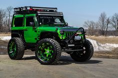 Premier Tire hooks up this Jeep Wrangler with 24x14 Massa-T in the same lime chrome wrap as the body with screw on caps. The Jeep Wrangler is a compact and mid-size four-wheel drive off-road and sport utility vehicle, manufactured by American automaker...