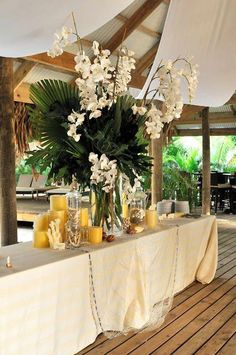 Beach wedding. White orchids and candles centerpiece