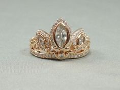 This Rapunzel tiara ring: | 29 Things To Help You Embrace Your Inner Disney Princess