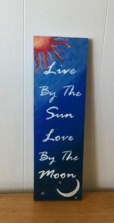 Live By The Sun Love by the Moon, Ready To Ship, wall hanging on reclaimed pallet wood. This hand-painted sign is good size, and measures approximately 17.5 x5.5 and is made from reclaimed pallet wood. It has been weatherized, so it can be hung indoors or out, and can come ready to hang, or as a shelf sitter. Thanks for visiting! You can see the rest of my original, happy energy art and one of a kind Goddess gifts in my shop at: www.Etsy.com/shop/SunStroked.  Or find me on Facebook ...