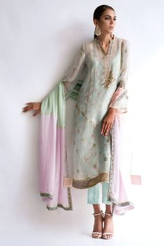Organza embroidered shirt with lace detailing. It comes with chiffon dupatta finished with organza ruffle detailing.*Raw silk pant with detailing at the bottom (to be sold separately)* This article is loose cut Pakistani Dresses, Indian Dresses, Indian Outfits, Kurta Designs, Saree Blouse Designs, Desi Wedding Dresses, Embroidery Suits Design, Fashion Outfits, Womens Fashion