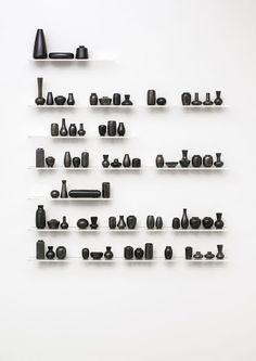 Marieke van Diemen - Poem 2003 installation, found black glazed vases, board, acryl - 240 x 170 x 12 cm  Poem II, 2007 Ultrachrome print, dibond, acryl