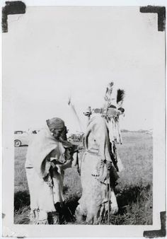 Blackfeet (Pikuni) women, 1937. Preparing a holy woman for a sun dance? JE