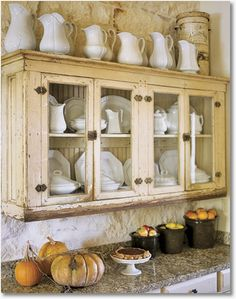 Vintage vases and dishes stored in this gorgeous rustic cabinet give this fall themed kitchen an inviting look Do you need a little inspiration for your kitchen? These French country kitchens are all stunning examples of country farmhouse style decor. Farmhouse Style Decorating, French Country Decorating, Farmhouse Decor, Cottage Decorating, Decorating Kitchen, Farmhouse Interior, French Country Kitchens, Country Farmhouse, Country French