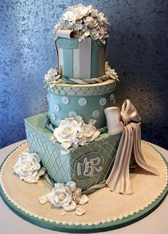 Wedding cake as 3 Victorian designed gift boxes. All edible, with buttercream, white chocolate and fondant decoration