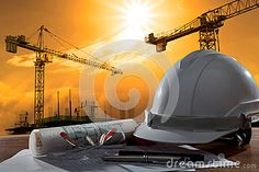 Safety Helmet And Architect Pland On Wood Table With Sunset Scen Stock Image - Image: 33574911