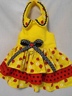 If you like lady bugs you are going to love this bright yellow dress. Has a three tier skirt and a cute peter pan collar. The dress is fully lined and has velcro closures at neck and chest that is adjustable for comfort. Also comes with a d ring for attaching a leash.  YOU CAN USE MY SIZE CHART BELOW OR SEND PETS MEASUREMENTS WHEN PLACING YOUR ORDER.  -----------------NECK-------------CHEST-------------LENGTH XXSM---------6-8----------------8-10----------------8…