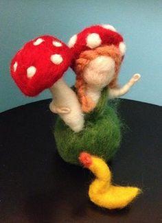 needled felted mushroom child with mushroom for dinner and ducky friend in tow.