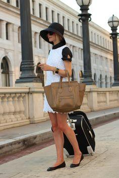 Bow Top: Kate Spade. Dress: Lilly. Shoes: Zara. Sunglasses: Karen Walker 'Super Duper'. Hat: Muji. Nails: Milani 'Juicy Glo' and Pop '24'. Jewelry: JCrew, Hermes, Stella, David Yurman, YSL, Pomellato, skull ring Big Bang. Purse: Celine. Suitcase: DVF.