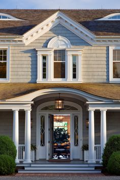 Love the arched entrance, lantern, and beautiful front door and sidelights!