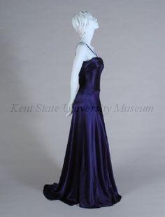 1939 attributed Dark blue silk satin crepe evening dress, bias cut, spaghetti straps, turned down bias bib over bust, train.