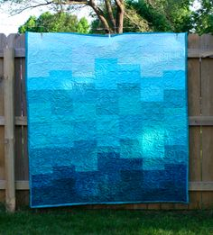 Tonya Dusold: Wave Goodbye! - love how the quilting gives this aqua quilt movement
